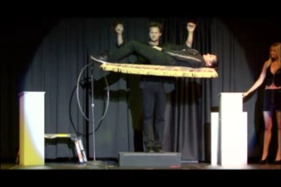 Andy Gross levitates a volunteer